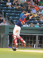 Catcher Blake Swihart (10) of the Greenville Drive reaches backward to catch a pop fly in a game against the Hickory Crawdads on Friday, August 31, 2012, at Fluor Field at the West End in Greenville, South Carolina. Swihart was a first-round pick (26th overall) by the Boston Red Sox in the 2011 First-Year Player Draft. Greenville won, 7-2. (Tom Priddy/Four Seam Images)