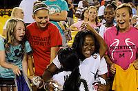 Marta (10) hugs a fan after the Women's Professional Soccer (WPS) All-Star Game at KSU Stadium in Kennesaw, GA, on June 30, 2010.