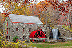Fall colors the gristmill  at the Wayside Inn  in Sudbury, MA, USA
