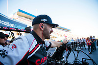 Oct 11, 2019; Concord, NC, USA; Dom Lagana, crew member for NHRA top fuel driver Steve Torrence during qualifying for the Carolina Nationals at zMax Dragway. Mandatory Credit: Mark J. Rebilas-USA TODAY Sports