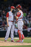 North Carolina State Wolfpack catcher Andrew Knizner (11) has a meeting on the mound with relief pitcher Jon Olczak (17) during the game against the Charlotte 49ers at BB&T Ballpark on March 31, 2015 in Charlotte, North Carolina.  The Wolfpack defeated the 49ers 10-6.  (Brian Westerholt/Four Seam Images)