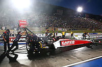 Jul. 18, 2014; Morrison, CO, USA; Crew members push NHRA top fuel driver Steve Torrence to the starting line during qualifying for the Mile High Nationals at Bandimere Speedway. Mandatory Credit: Mark J. Rebilas-