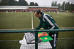 The New Saints 4 Bohemians 0, 20/07/2010. Park Hall Stadium, Champions League 2nd qualifying round 2nd leg. Fourth official Ferenc Bede of Hungary preparing the substitutes board during the The New Saints versus Bohemians game at Park Hall Stadium, Oswestry in the Champions League 2nd qualifying round 2nd leg game. Despite leading 1-0 from the first leg, the Dublin club went out following their 4-0 defeat by the Welsh champions. The match was the first-ever Champions League match in the UK played on an artificial pitch and was staged at the Welsh Premier League's ground which was located over the border in England. Photo by Colin McPherson.