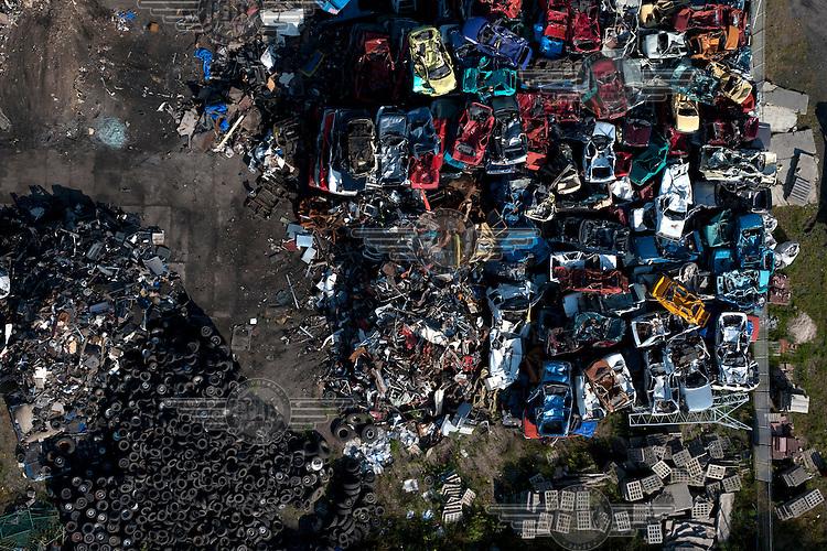 Cars lie in a scrap metal heap in Gdansk.