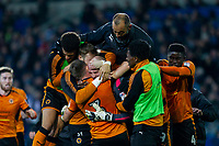 Wolves players and manager Nuno Espirito Santo (top) celebrate at full time of the Sky Bet Championship match between Cardiff City and Wolverhampton Wanderers at the Cardiff City Stadium, Cardiff, Wales on 6 April 2018. Photo by Mark  Hawkins / PRiME Media Images.