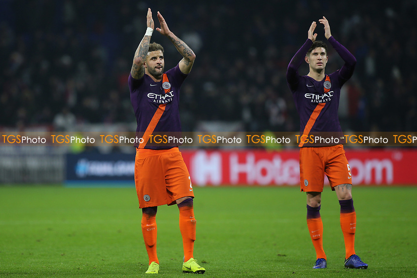 Manchester City's Kyle Walker and John Stones applaud their fans at the final whistle during Lyon vs Manchester City, UEFA Champions League Football at Groupama Stadium on 27th November 2018