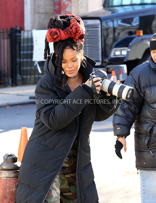 www.acepixs.com<br /> <br /> November 22 2016, New York City<br /> <br /> Actress and singer Rihanna borrows a photographer's camera on the set of the new movie 'Ocean's Eight' on November 22 2016 in New York City<br /> <br /> By Line: Zelig Shaul/ACE Pictures<br /> <br /> <br /> ACE Pictures Inc<br /> Tel: 6467670430<br /> Email: info@acepixs.com<br /> www.acepixs.com