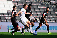 Milton Keynes Dons' Callum Brittain shields the ball from `Lincoln City's Conor McGrandles, left, and Timothy Eyoma<br /> <br /> Photographer Chris Vaughan/CameraSport<br /> <br /> The EFL Sky Bet League One - Milton Keynes Dons v Lincoln City - Saturday 19th September 2020 - Stadium MK - Milton Keynes<br /> <br /> World Copyright © 2020 CameraSport. All rights reserved. 43 Linden Ave. Countesthorpe. Leicester. England. LE8 5PG - Tel: +44 (0) 116 277 4147 - admin@camerasport.com - www.camerasport.com