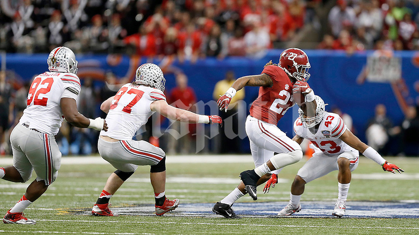 Alabama Crimson Tide running back Derrick Henry (27) gets away from Ohio State Buckeyes defensive lineman Adolphus Washington (92), Ohio State Buckeyes defensive lineman Joey Bosa (97) and Ohio State Buckeyes linebacker Darron Lee (43) during the fourth quarter in the Allstate Sugar Bowl college football playoff semifinal at Mercedes-Benz Superdome in New Orleans on Thursday, January 1, 2015. (Columbus Dispatch photo by Jonathan Quilter)