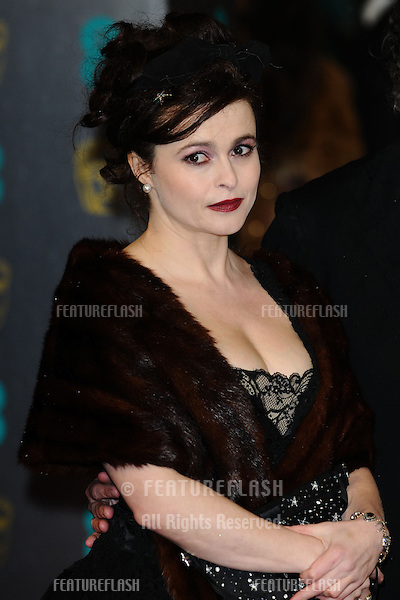 Helena Bonham Carter and Tim Burton arriving for the EE BAFTA Film Awards 2013 at the Royal Opera House, Covent Garden, London. 10/02/2013 Picture by: Steve Vas / Featureflash