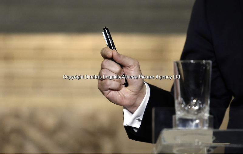 Pictured: A pen held by Alexis Tsipras Friday 27 May 2016<br /> Re: Russian President Vladimir Putin with Greek Prime Minister Alexis Tsipras during a press conference at Maximou Mansion, Athens, Greece