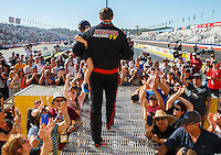 Nov 13, 2016; Pomona, CA, USA; NHRA top fuel driver Morgan Lucas holds his sons during driver introductions prior to the Auto Club Finals at Auto Club Raceway at Pomona. Mandatory Credit: Mark J. Rebilas-USA TODAY Sports