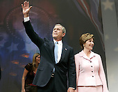 United States President George W. Bush and first lady Laura Bush arrive at a victory celebration at the Ronald Reagan Building, November 3, 2004 in Washington DC. After deciding not to contest the votes in the battleground state of Ohio, Democratic presidential candidate Senator John Kerry (Democrat of Massachusetts) called President Bush to concede and congratulated him.   <br /> Credit: Mark Wilson / Pool via CNP