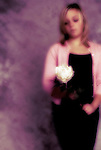 A girl holding a white rose