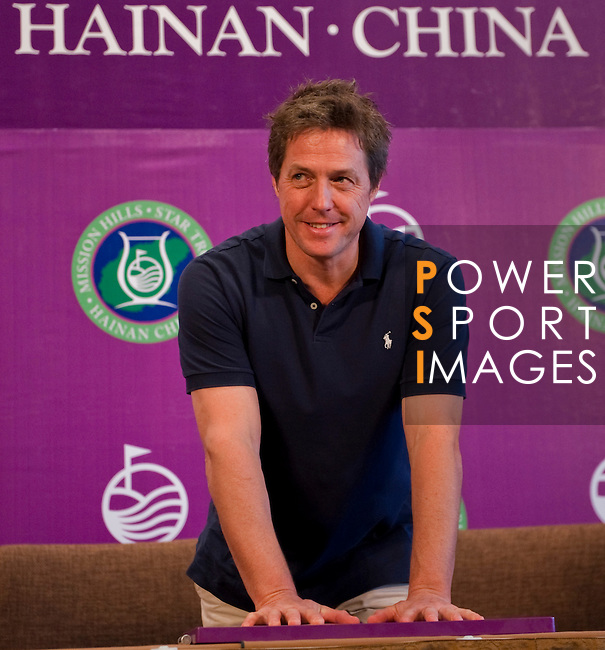HAIKOU, CHINA - OCTOBER 28:  Hollywood actor Hugh Grant of Great Britain impresses his handprints during a press conference as part of the Mission Hills Star Trophy on October 28, 2010 in Haikou, China. The Mission Hills Star Trophy is Asia's leading leisure liflestyle event and features Hollywood celebrities and international golf stars.  Photo by Victor Fraile / The Power of Sport Images