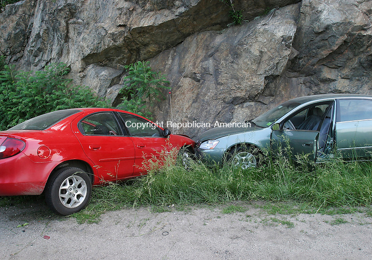 MIDDLEBURY, CT - 09 June 2005 -060905BZ05- Two cars collided and came to rest off the highway against a rock wall on I-84 Westbound in Middlebury Thursday evening. There did not appear to be any injuries.<br />  Jamison C. Bazinet Photo