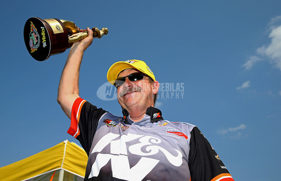 Aug. 18, 2013; Brainerd, MN, USA: NHRA pro stock driver Mike Edwards celebrates after winning the Lucas Oil Nationals at Brainerd International Raceway. Mandatory Credit: Mark J. Rebilas-