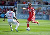 Chicago defender Gonzalo Segares (13) takes on New York midfielder Dane Richards (19).  The Chicago Fire tied the New York Red Bulls 1-1 at Toyota Park in Bridgeview, IL on June 26, 2011.