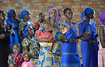 People celebrate Mass in the Catholic Church in the middle of a camp for more than 5,000 displaced people in Riimenze, in South Sudan's Gbudwe State, what was formerly Western Equatoria. Families here were displaced at the beginning of 2017, as fighting between government soldiers and rebels escalated.<br /> <br /> Two Catholic groups, Caritas Austria and Solidarity with South Sudan, have played key roles in assuring that the displaced families here have food, shelter and water.<br /> The camp formed around the Catholic Church in Riimenze as people fled violence in nearby villages for what they perceived as the safety offered by the church.