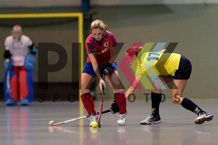 GER - Mannheim, Germany, January 17: During the Oberliga-Damen indoor hockey match between Feudenheimer HC (red) and  TSV Ludwigsburg (yellow) on January 17, 2016 at Irma-Roechling-Halle in Mannheim, Germany. Final score 8-2 (HT 3-1).  Andrea Vogt #4 of Feudenheimer HC, Huelya Oezer  #17 of TSV Ludwigsburg<br /> <br /> Foto &copy; PIX-Sportfotos *** Foto ist honorarpflichtig! *** Auf Anfrage in hoeherer Qualitaet/Aufloesung. Belegexemplar erbeten. Veroeffentlichung ausschliesslich fuer journalistisch-publizistische Zwecke. For editorial use only.