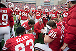 Wisconsin Badgers defensive line coach Charlie Partridge talks to the defensive lineman during an NCAA college football game against the Indiana Hoosiers on November 13, 2010 at Camp Randall Stadium in Madison, Wisconsin. The Badgers won 83-20. (Photo by David Stluka)