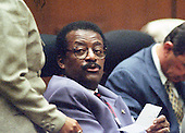 Lead defense attorney Johnnie L. Cochran, Jr. confers with a member of his staff during the trial of former NFL star running back O.J. Simpson for the murder of his former wife, Nicole Brown Simpson and a friend of hers, restaurant waiter, Ron Goldman in Los Angeles County Superior Court in Los Angeles, California on July 13, 1995.<br /> Credit: Steve Grayson / Pool via CNP