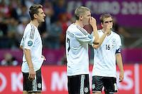 FUSSBALL  EUROPAMEISTERSCHAFT 2012   HALBFINALE Deutschland - Italien              28.06.2012 Miroslav Klose, Bastian Schweinsteiger und Philipp Lahm (v.l., alle Deutschland) sind nach dem Abpfiff enttaeuscht