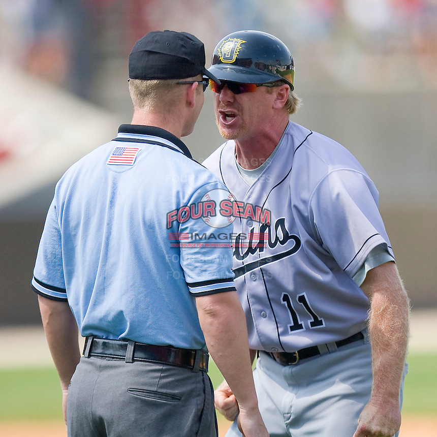 Jacksonville Suns manager Tim Leiper #11 argues a call with first base umpire Sean Barber at Five County Stadium May 16, 2010, in Zebulon, North Carolina.  Photo by Brian Westerholt /  Seam Images