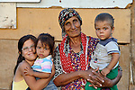 "THIS PHOTO IS AVAILABLE AS A PRINT OR FOR PERSONAL USE. CLICK ON ""ADD TO CART"" TO SEE PRICING OPTIONS.   Ganime Makmovida, 68, poses with members of her family in the largely Roma neighborhood of Gorno Ezerovo, part of the Bulgarian city of Burgas. Residents here don't self-identify much as Roma, because of the negative connotations associated with the word, so many refer to themselves as a Turkish-speaking minority. This woman participates in the local United Methodist congregation."