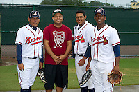 GCL Braves pitcher Andy Otero (8), first baseman Ibrahim McKenzie (48) and Oriel Caicedo (11) pose with a fan after a game against the GCL Blue Jays on July 15, 2013 at Disney's Wide World of Sport in Orlando, Florida.  The game was called in the 4th inning due to rain storms with the Braves leading 5-0.  (Mike Janes/Four Seam Images)