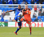 Cardiff's Kagisho Dikgacoi tussles with Ipswich's Freddie Sears during the Sky Bet Championship League match at The Cardiff City Stadium.  Photo credit should read: David Klein/Sportimage