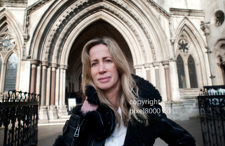 HIgh Court RCJ  16.1.13<br /> Michelle Young leaves the High Court in London today after her former husband Scot was jailed <br /> <br /> <br /> <br /> Pic by Gavin Rodgers/Pixel 8000 Ltd