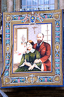 A tapestry showing Louis and Zelie Martin hang from the balconies of St. Peter's in Vatican.Pope Francis celebrates a Holy Mass for the canonization of four new saints: Vincenzo Grossi, Mary of the Immaculate Conception, Louis Martin and his wife Zélie Guérin, the first-ever married couple with children to be canonized in the same ceremony.Vatican City, Vatican. 18th October 2015