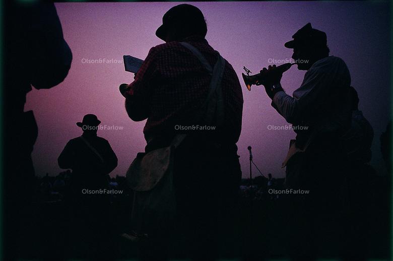 A small band plays taps at a Civil War Reenactment of a battle in Mannassas.