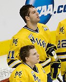 Shawn Hunwick (Michigan - 31), Kevin Lynch (Michigan - 11) - The University of Minnesota-Duluth Bulldogs defeated the University of Michigan Wolverines 3-2 (OT) to win the 2011 D1 National Championship on Saturday, April 9, 2011, at the Xcel Energy Center in St. Paul, Minnesota.