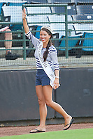 Jodie McLaughlin, Miss Charlotte USA 2011, waves to the crowd after throwing out the first pitch prior to the International League game between the Indianapolis Indians and the Charlotte Knights at Knights Stadium on July 26, 2011 in Fort Mill, South Carolina.   (Brian Westerholt / Four Seam Images)