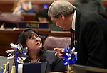 Nevada Assembly members Irene Bustamante Adams, D-Las Vegas, and John Ellison, R-Elko, work on the Assembly floor at the Legislative Building in Carson City, Nev., on Tuesday, April 23, 2013. .Photo by Cathleen Allison