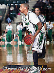 North Texas Mean Green guard Tristan Thompson (14) looks for a open team member in the game between the Jackson State Tigers and the University of North Texas Mean Green at the North Texas Coliseum,the Super Pit, in Denton, Texas. UNT defeated Jackson 68 to 49