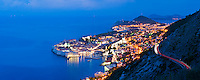 Panoramic photo of Dubrovnik Old Town at night, taken from Zarkovica Hill, Dalmatian Coast, Croatia, Europe. This panoramic photo of Dubrovnik Old Town at night, jutting out into the Mediterranean Sea was taken from Zarkovica Hill on the Dalmatian Coast in Croatia. By far the best views of Dubrovnik Old Town are from elevated points such as Zarkovica Hill and Mount Srd, which can be seen on the right of the photo.