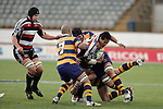 Ross  Kennedy arrives to lend support to Niva Ta'auso as he is taken to ground by 3 Bay defenders during the Air NZ Cup rugby game between Bay of Plenty & Counties Manukau played at Blue Chip Stadium, Mt Maunganui on 16th of September, 2006. Bay of Plenty won 38 - 11.