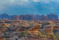March 14, 2018: Late winter storm clouds brew over the iconic spires of The Needles District, Canyonlands National Park, Utah.