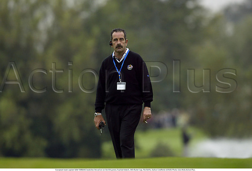 European team captain SAM TORRANCE watches the action on the 6th green, Fourball Match, 34th Ryder Cup, The Belfry, Sutton Coldfield, 020928. Photo: Glyn Kirk/Action Plus....2002.golf golfers player.cigarette smoking smoker headphone radio