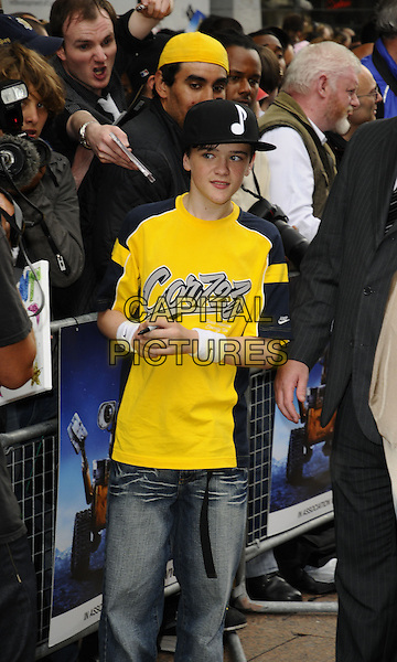 "GEORGE SAMPSON.The ""Wall-E"" UK premiere, Empire Cinema, LEicester Square, London, England..July 13th, 2008.half length black musical note baseball cap hat yellow top t-shirt jeans denim 3/4 .CAP/CAN.©Can Nguyen/Capital Pictures."