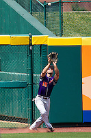 Jason Hockemeyer (15) of the Evansville Purple Aces catches a ball hit to left field during a game against the Missouri State Bears at Hammons Field on May 12, 2012 in Springfield, Missouri. (David Welker/Four Seam Images)