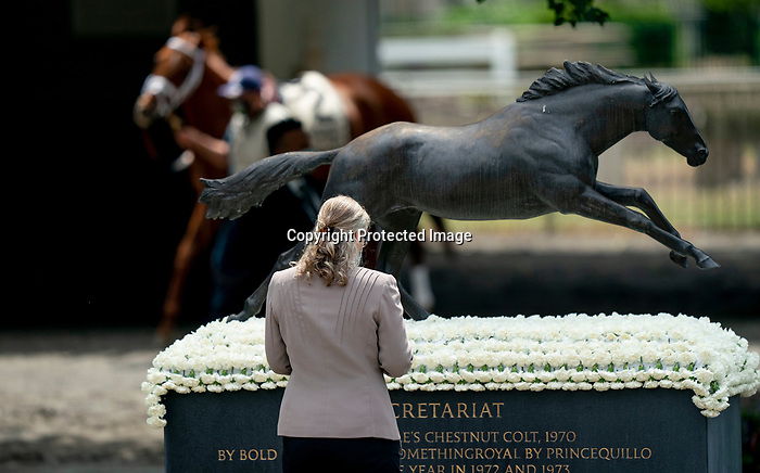 A woman stands by the Secretariat statue in the paddock at Belmont race track in Elmont, New York, USA, 20 June 2020. The Belmont is being run without fans due to coronavirus SARS-CoV-2 which causes the Covid-19 disease and while it has always been the third leg of the Triple Crown, due to Covid-19 it is, instead the first leg in 2020.