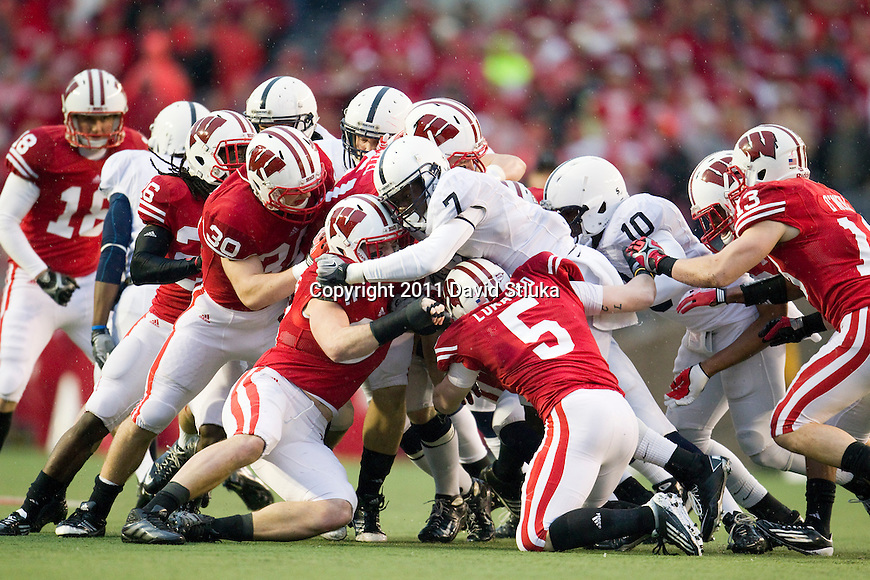 Wisconsin Badgers kickoff team gang tackles a Penn State Nittanty Lions kick returner during an NCAA Big Ten Conference college football game on November 26, 2011 in Madison, Wisconsin. The Badgers won 45-7. (Photo by David Stluka)