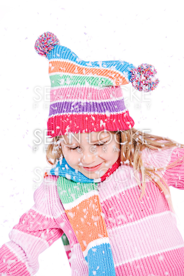 Series with little girl in winter clothing.  Isolated on white, and also set outdoors.