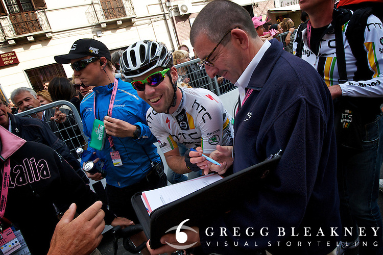 Cav signs out with a UCI official after winning stage 10.