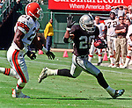 Oakland Raiders vs. Cleveland Browns at Oakland Alameda County Coliseum Sunday, September 24, 2000.  Raiders beat Browns  36-10.  Cleveland Browns defensive back Marquis Smith (21) chases Oakland Raiders running back Napoleon Kaufman (26).