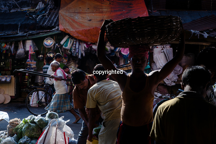 People walk along a street in the market stall in Kolkata, India, on Saturday, May 27, 2017. Photographer: Sanjit Das